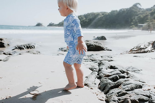 bare and boho swim suit swim onesie swimwear toddler on sandy beach
