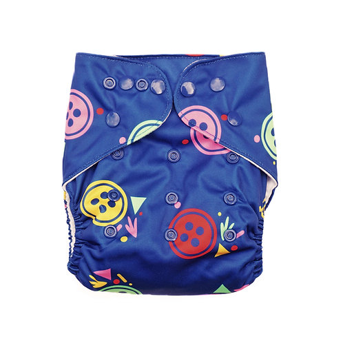 evia nappies reusable cloth nappy pocket nappy buttons in bright colours on blue background