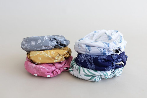 Flaww - Bare and Boho new born reusable cloth nappies. bundle of nappies in a stack.