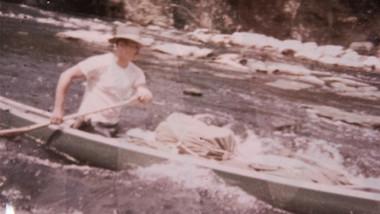 Jack McKey paddling canoe