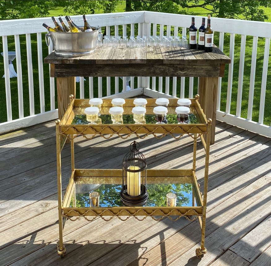 Beautiful antique gold wine bar with protective Stancaps, backed by a hand crafted salvaged wood table.