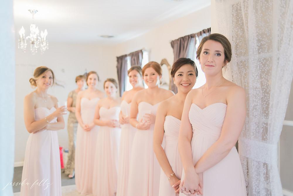 bridalmaids seeing dress on bride
