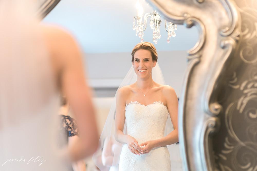 Bride looking into mirrow