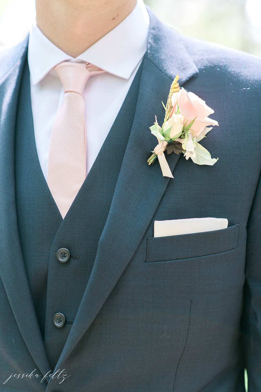 grooms' suit closeup