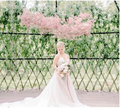 Style shoot from Willow Chapel with this gorgeous blush & ivory hue gown. Paired with a dreamy cathedral tulle train and soft feminine sweetheart neckline, the setting is matched with the perfect Summer florals at Black Iris Estate. Photographer: Alison Mae Photography