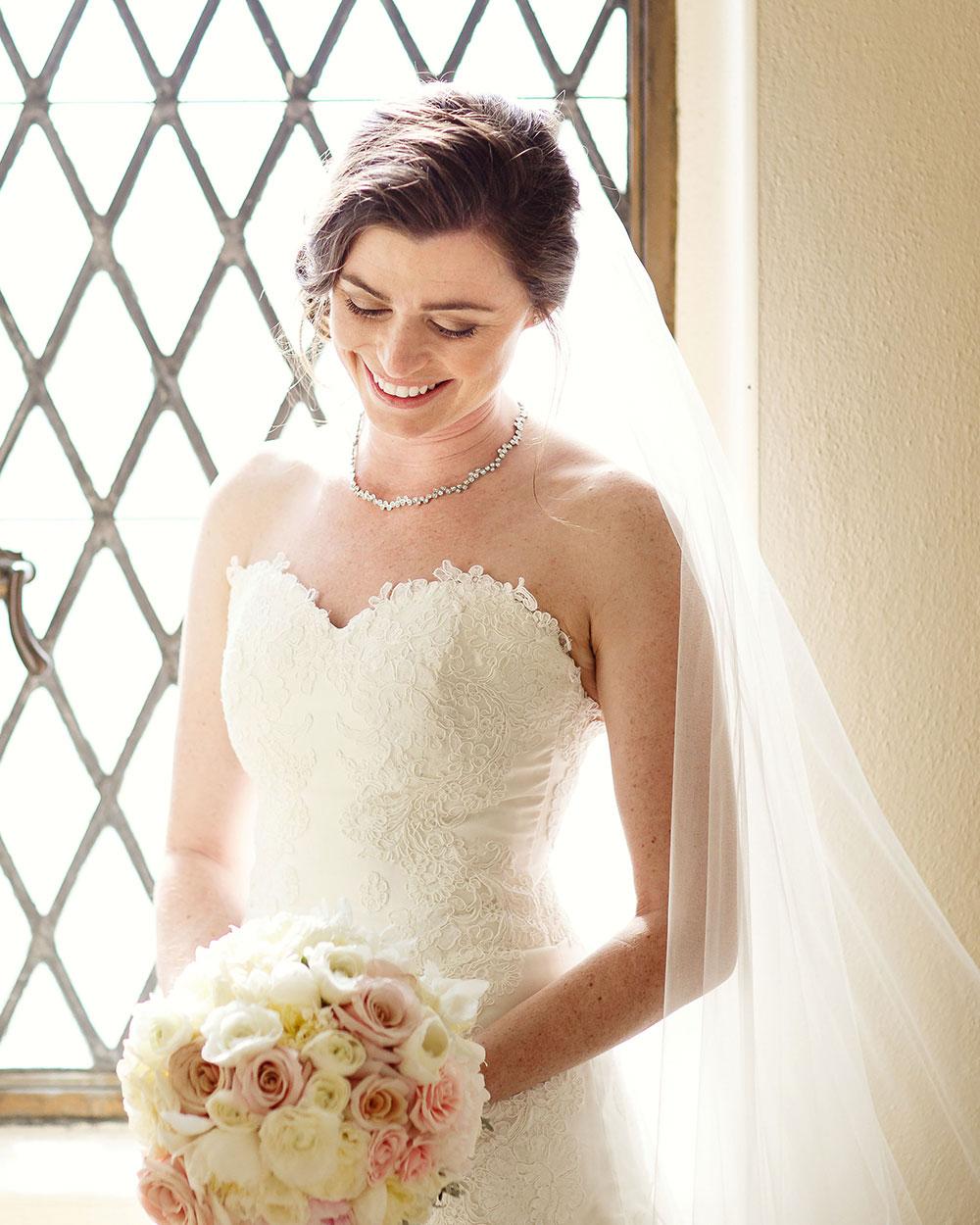 Window shot of bride