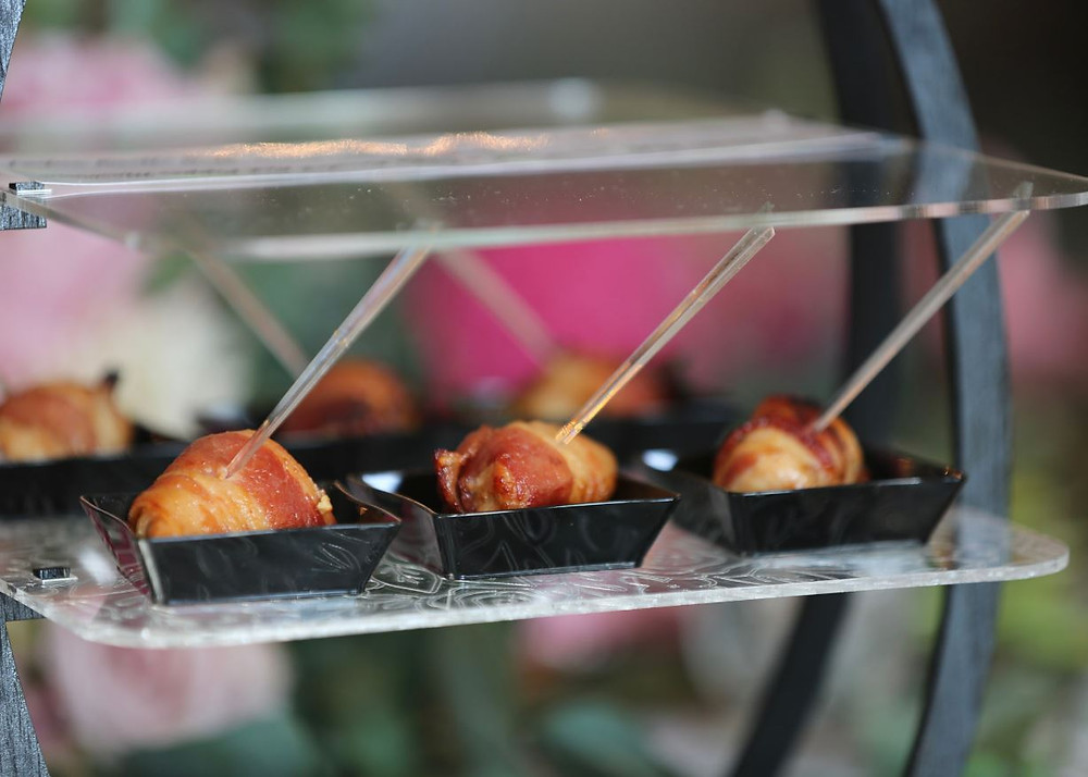 Savory Chicken Breast wrapped in Bacon and marinated in a Korean Sauce is passed on our custom-made passing trays with built in sneeze guards. Each hors d'oeuvre is placed on its own individual vestal to limit multiple touches by guests.