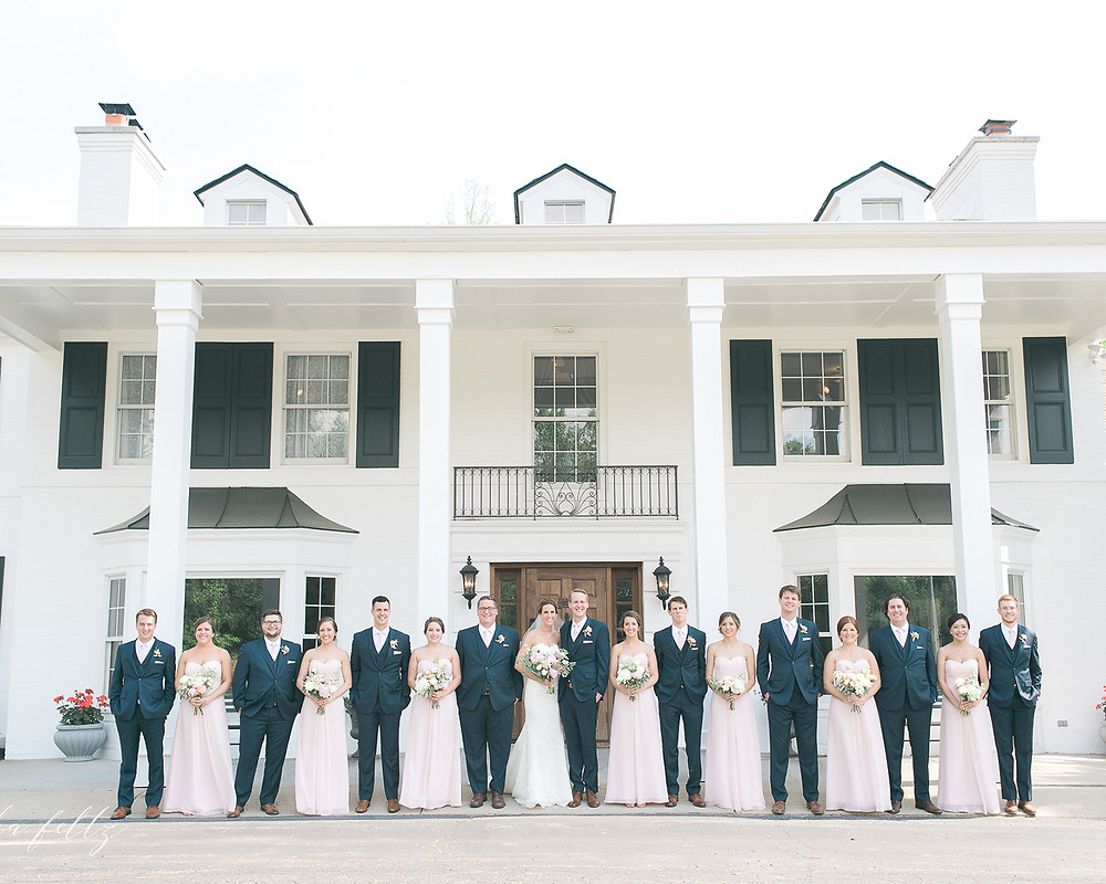 bridal party infront of mansion