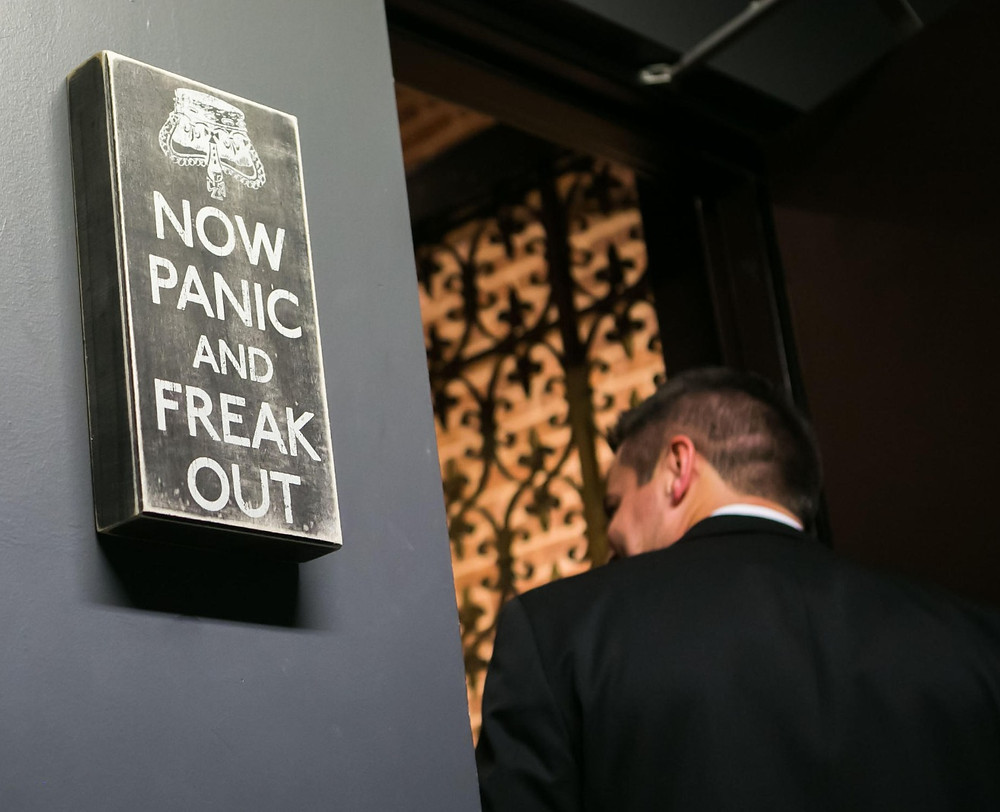 "This ""Now Panic & Freak Out"" sign hangs at the grooms entrance into the 2nd Floor Ceremony Area at CANAL 337. Out team at Thomas Caterers of Distinction will take the panic out of Wedding Planning."