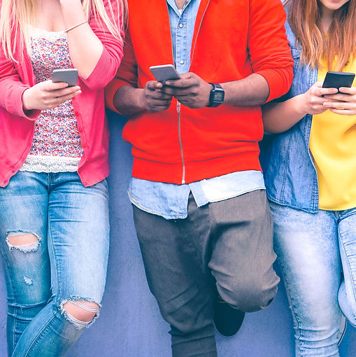 Teenagers texting mobile phone messages