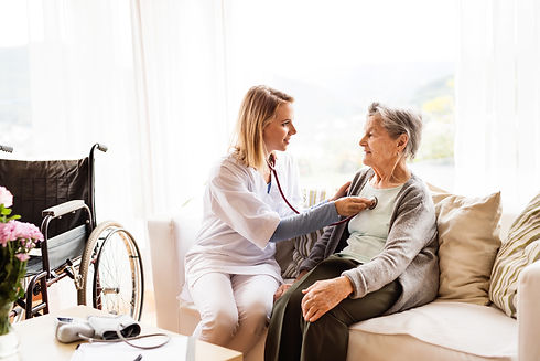 Health visitor and a senior woman during