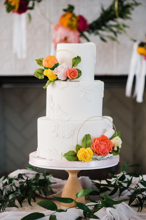 Citrus lace wedding cake with sugar florals