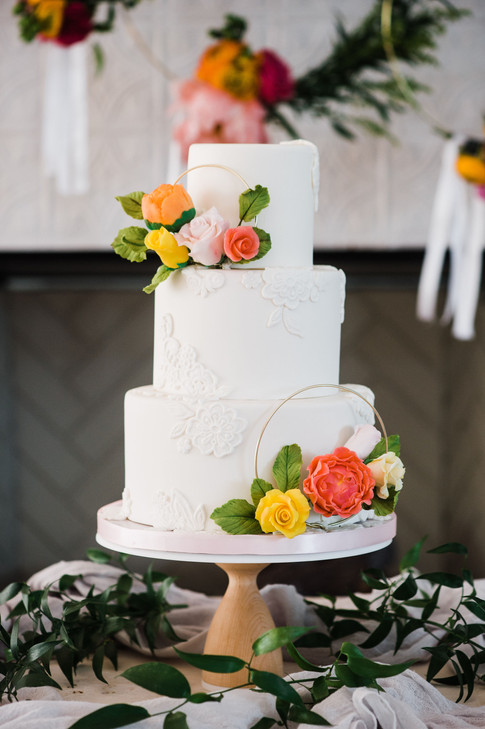 Citrus lace wedding cake with sugar florals