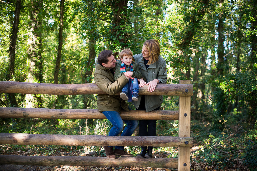 Father, mother and little boy in the woods