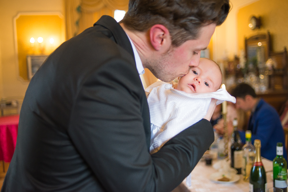 Dad kissing baby - Christening Photography by Camila Lee
