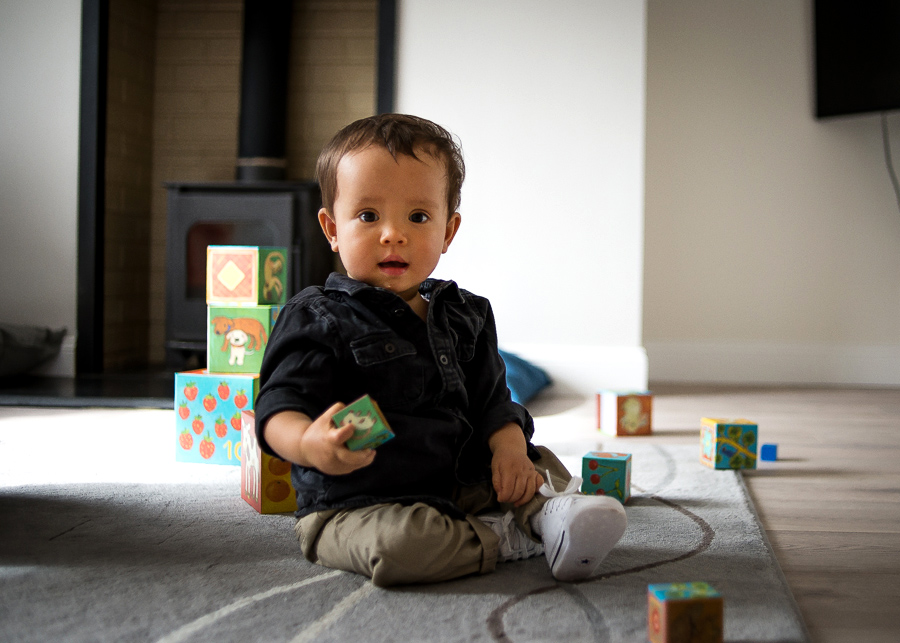 Baby boy playing with blocks - Family session at home in Dublin by Camila Lee