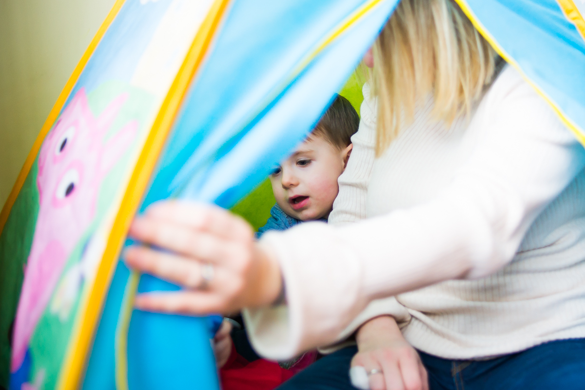 Mum and little boy in tent - Family photography session at home in Dublin by Camila Lee