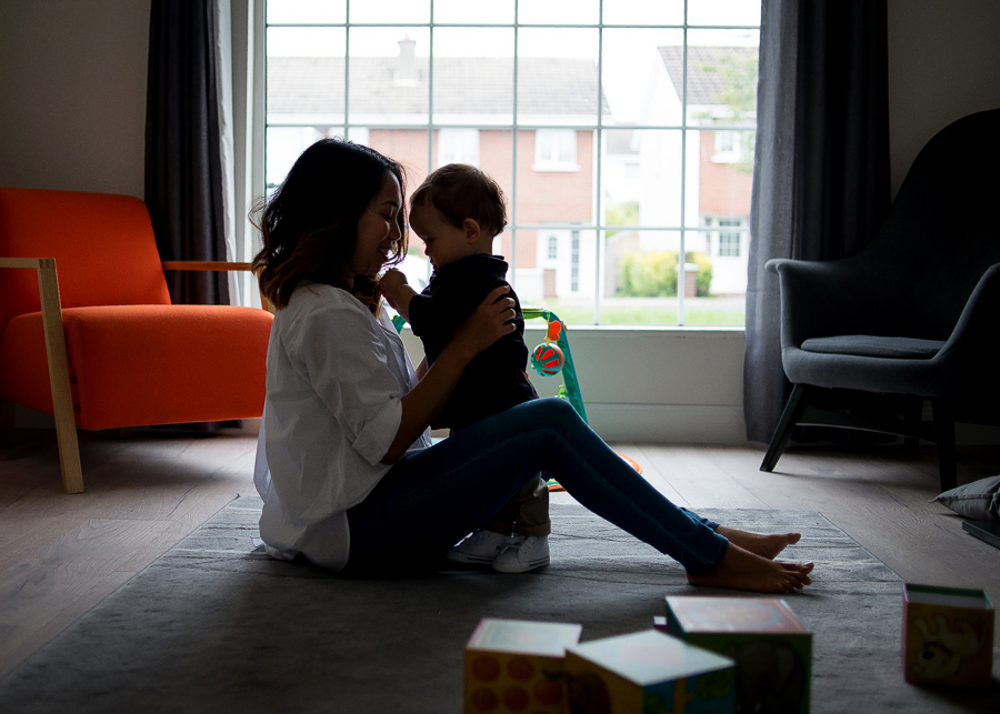 Mum and baby in the living rom - Family session at home in Dublin by Camila Lee