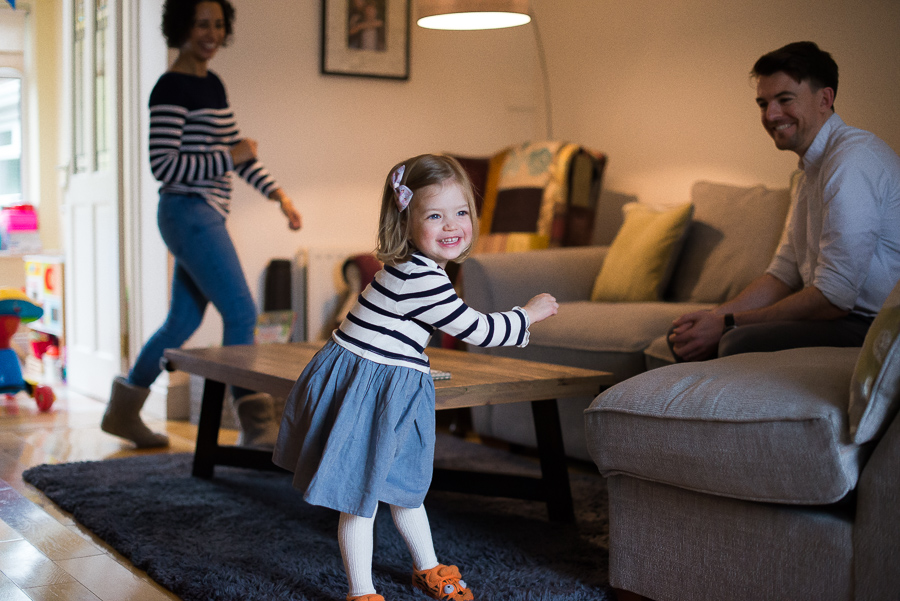 Family dancing at home in Dublin by photographer Camila Lee