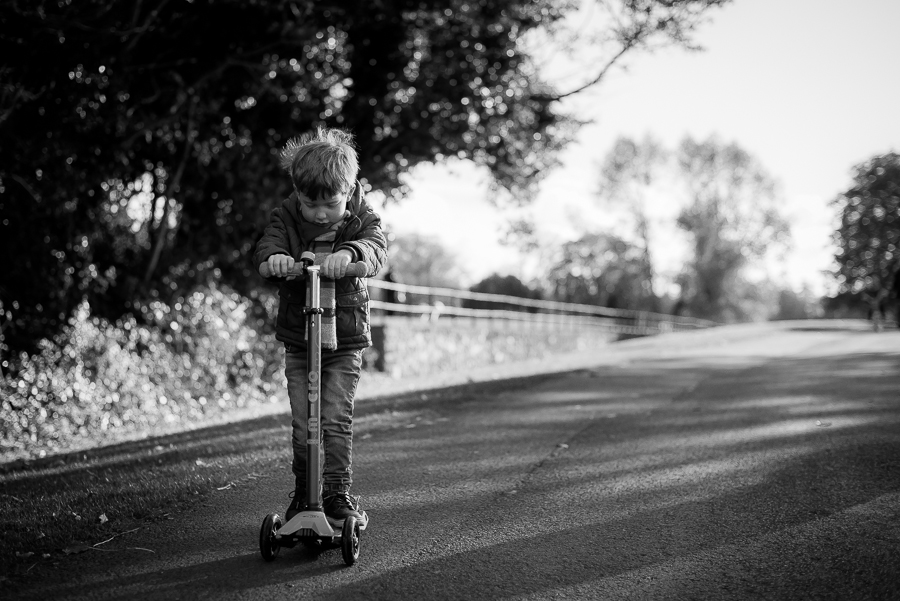 Boy on scooter - Family Photography Session by Camila Lee at Malahide Castle, Dublin