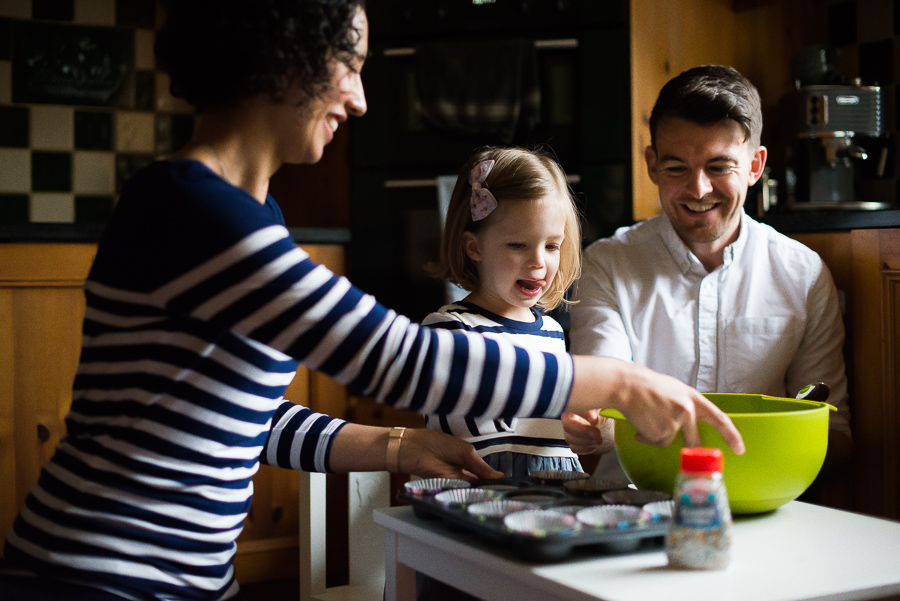 Family photoshoot at home in Dublin by Camila Lee - Mum, Dad and daughter Cooking