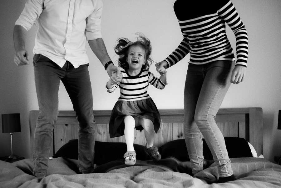 Family jumping on the bed - photoshoot at home in Dublin by Camila Lee