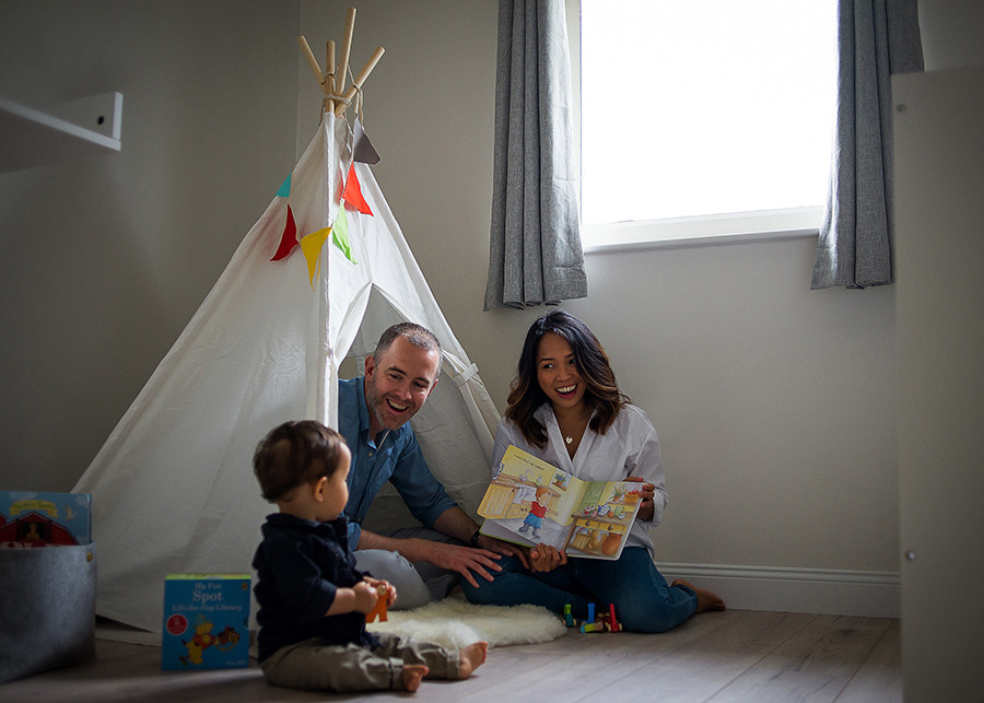 Mom and dad reading for baby