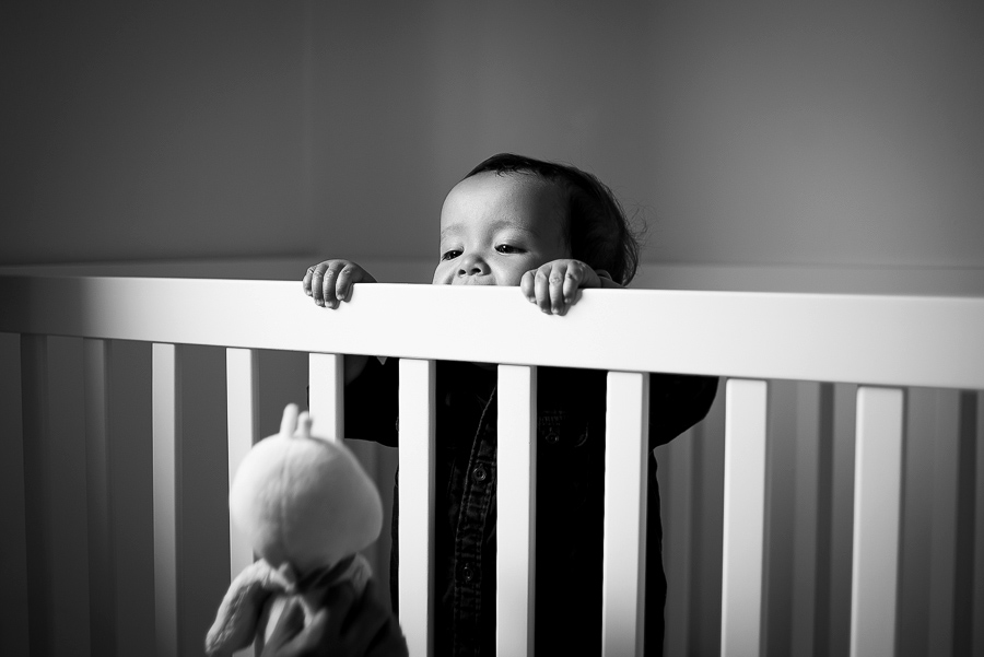 Baby boy in the cot - Family photography session at home in Dublin by Camila Lee