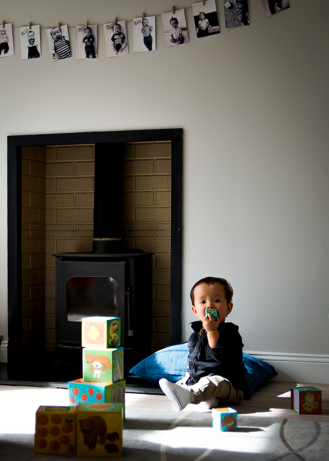 Baby oy playing with blocks - Family session at home in Dublin by Camila Lee