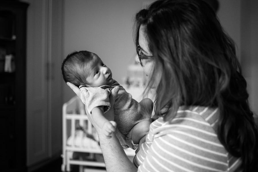 Newborn baby looking at mom