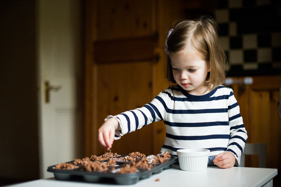 Girl baking - Family photoshoot at home in Dublin by Camila Lee