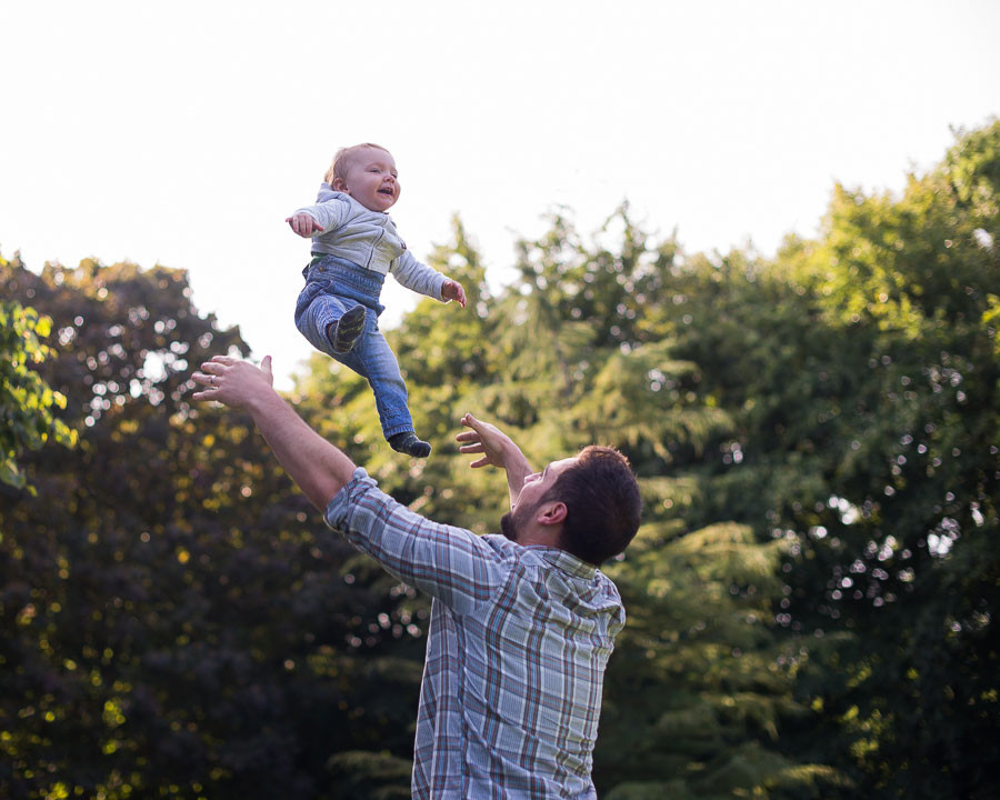 Dad throwing baby in the air