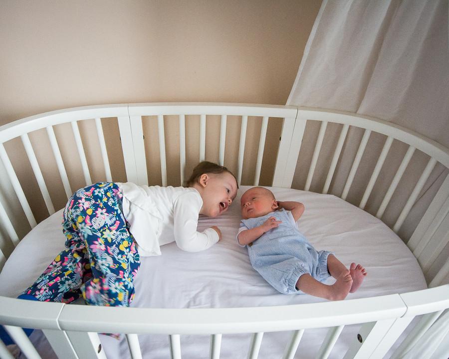 Siblings in the crib