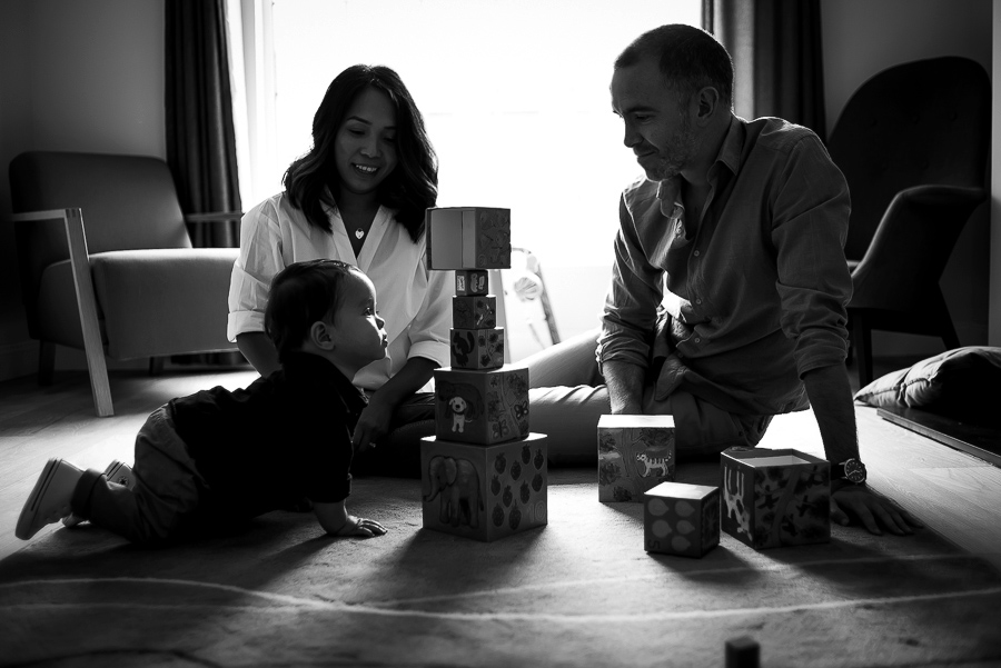 Mum, dad and baby playing with blocks - Family session at home in Dublin by Camila Lee