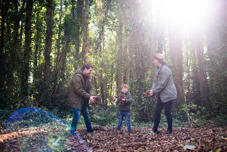 Family playing in the woods