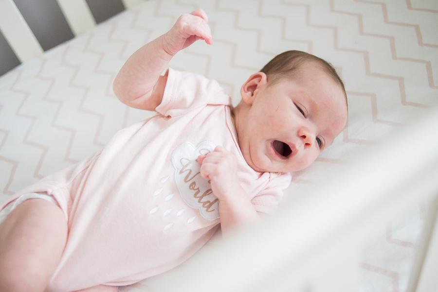 Newborn baby Yawning. Photo by Camila Lee
