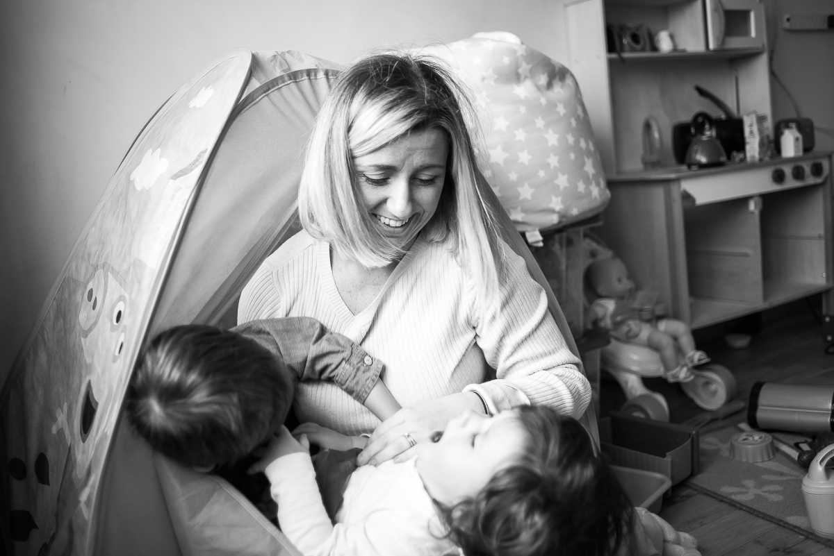 Mum and kids in tent - Family photography session at home in Dublin by Camila Lee