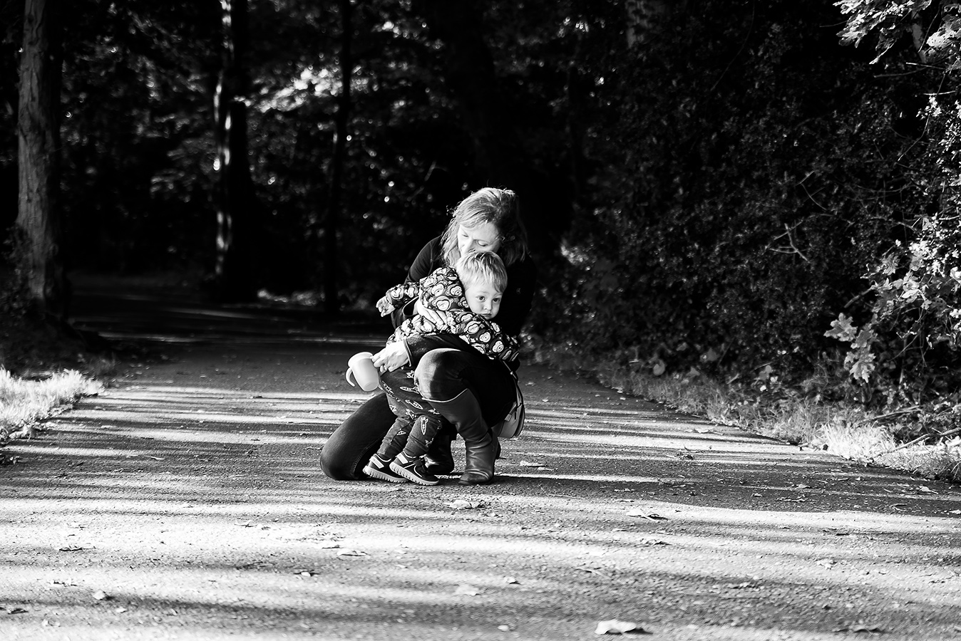 Mother hugging son - Family Photoshoot at Marlay Park in Dublin by Camila Lee