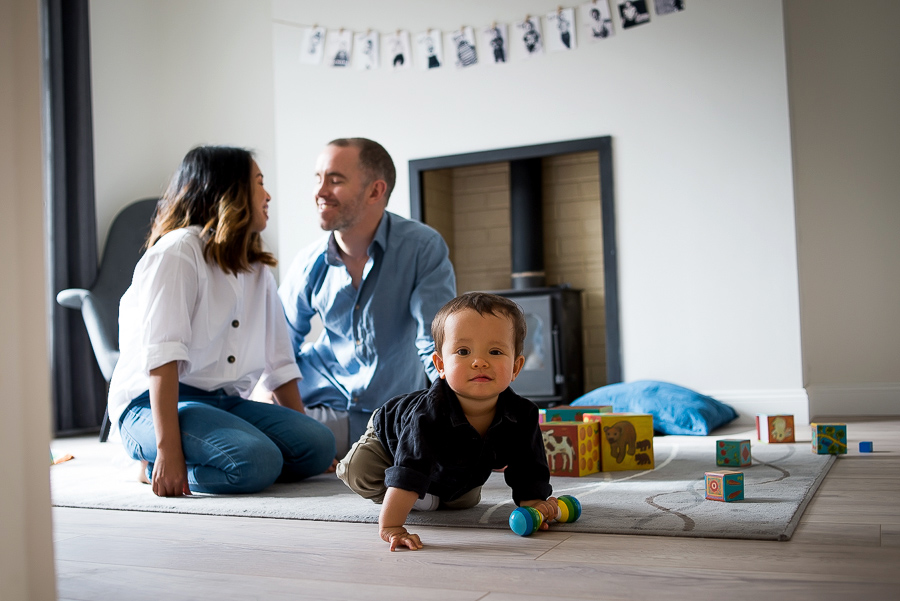Mum, dad and baby in the living room - Family photography session at home in Dublin by Camila Lee