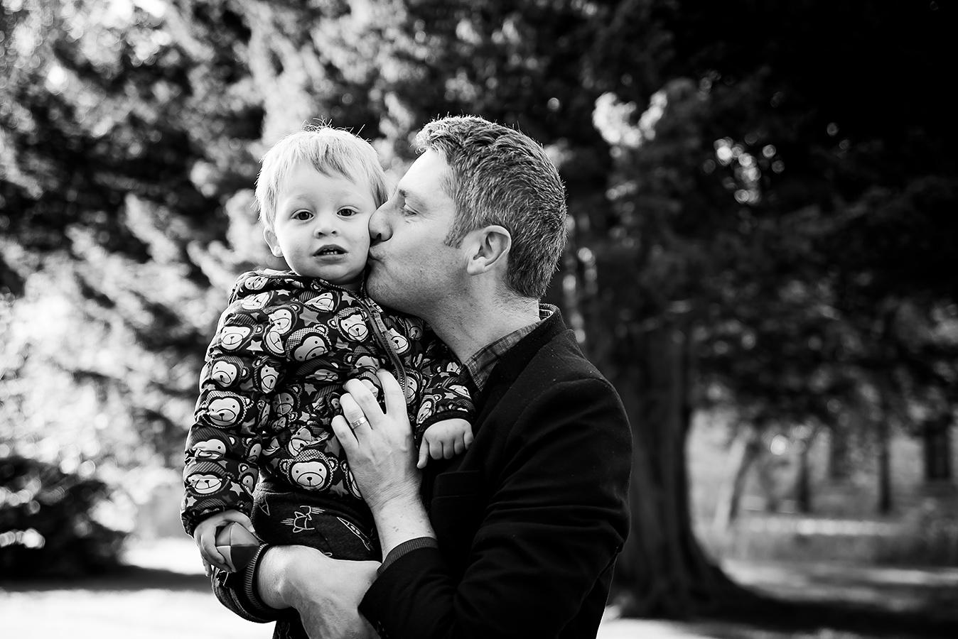 Dad kissing son - Family Photoshoot at Marlay Park in Dublin by Camila Lee