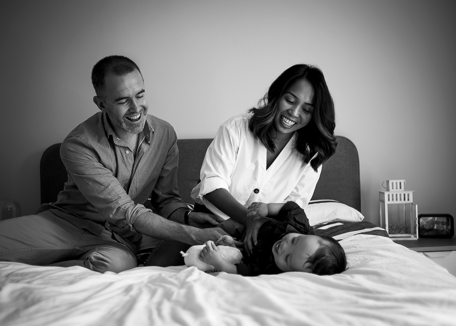 Mum and dad tickling baby - Family photography session at home in Dublin by Camila Lee