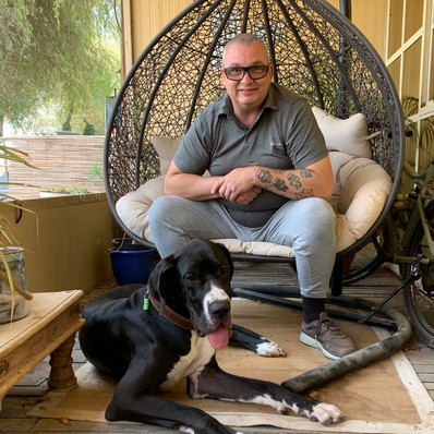 Neil & Duchess (our Great Dane).  Over the years we have had 15 Great Danes, all adopted.