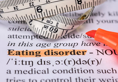 Words eating disorder with highlighter and measuring tape.jpg