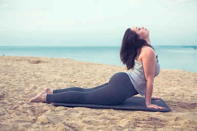 Young woman doing yoga exercise outdoors.jpg