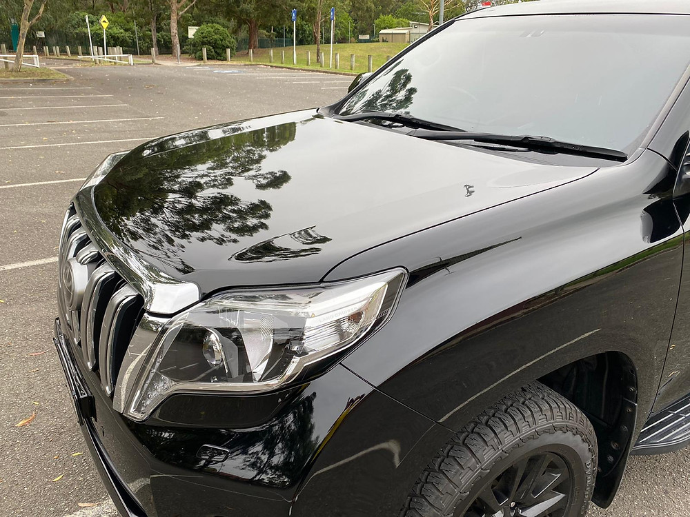 Mobile Ceramic Coating on a used black SUV executed to perfection by Hot Ride mobile car detailing Sydney