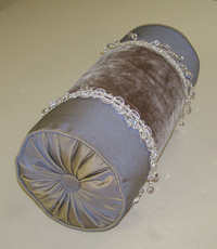 Bolster pillow with lots of bling