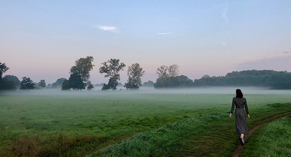 Lonnies Planet walking through field before sunrise Hof ter Laken Belgium
