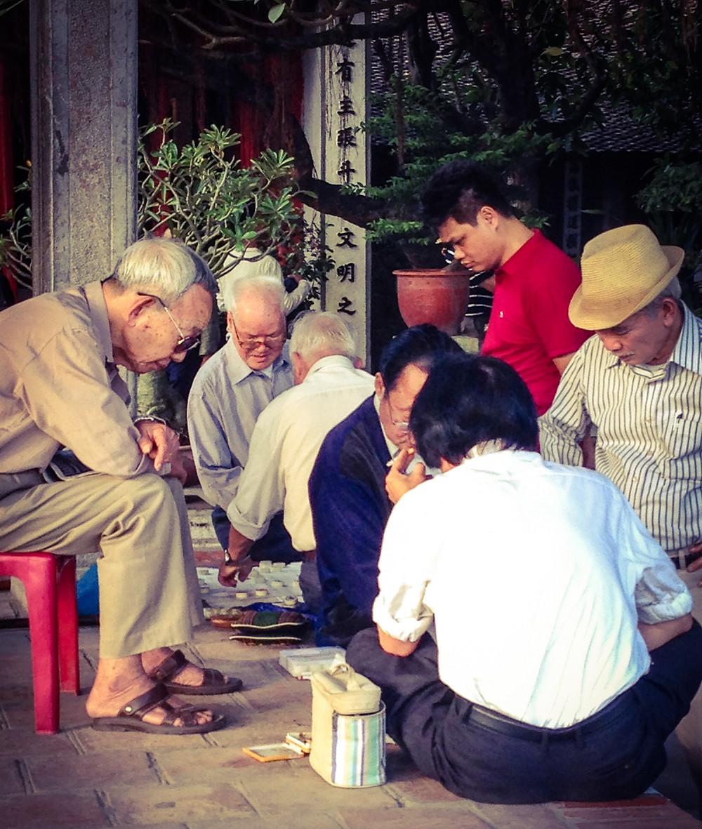 Men playing a board game in Hanoi, Vietnam
