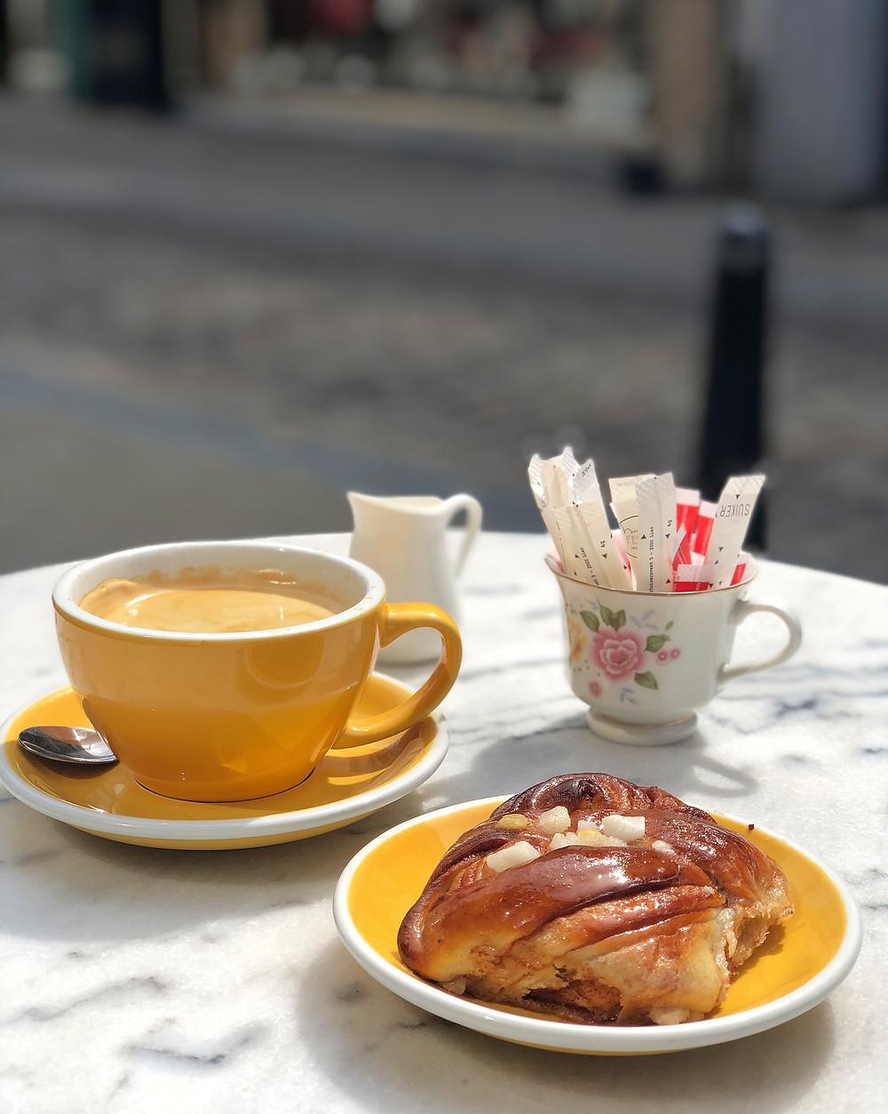 Coffee and cinnamon bun at Feliks Lier