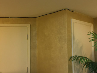"""""""Before"""" shot of elevator lobby exposed cable wire"""